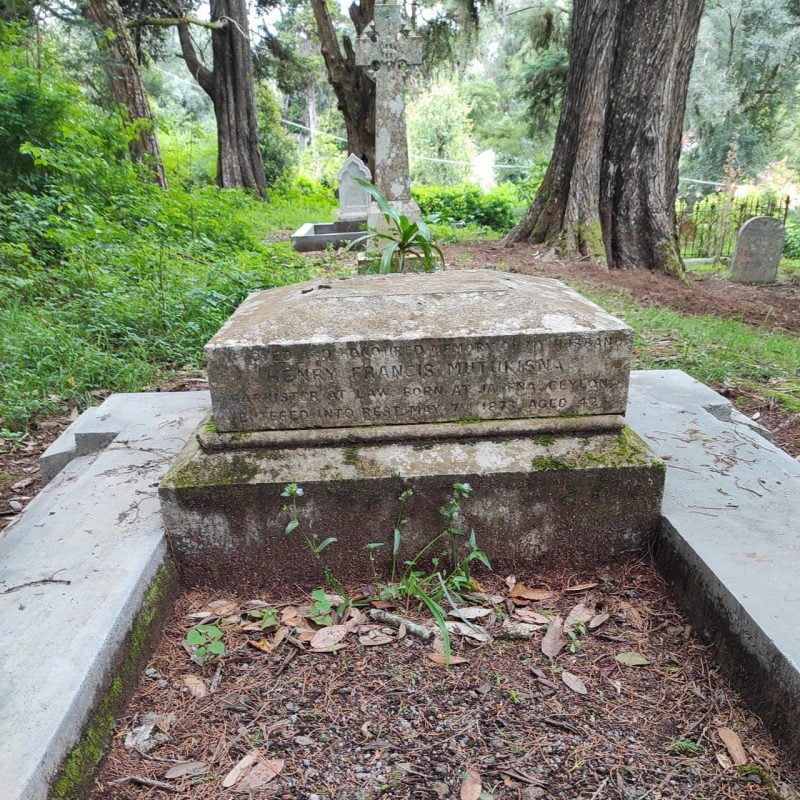 The moss-covered grave of Henry Francis Mutukisna