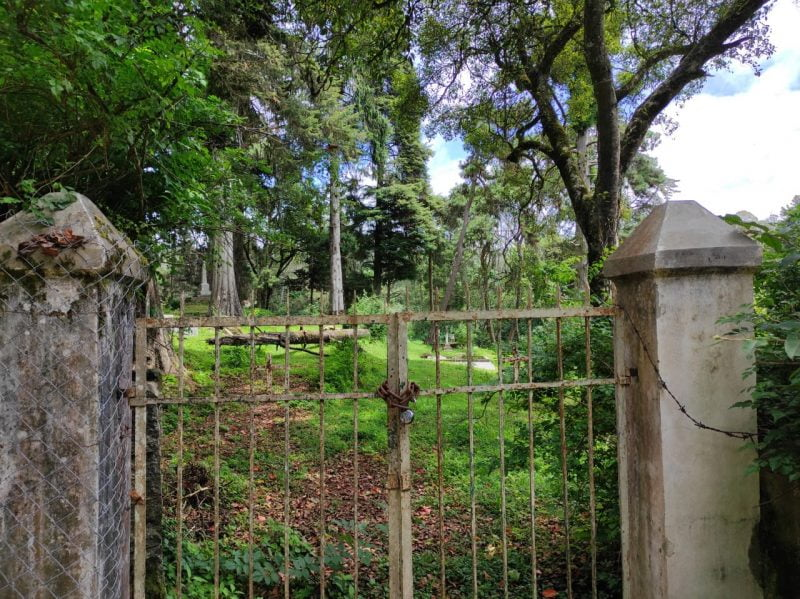 The locked gates leading to the cemetery
